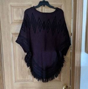 Purple and black frilled poncho sweater